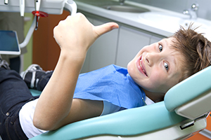 Boy Smiling in Dental Chair